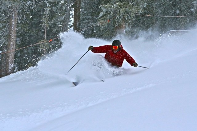 A skier finds deep powder at Crested Butte. - © Crested Butte