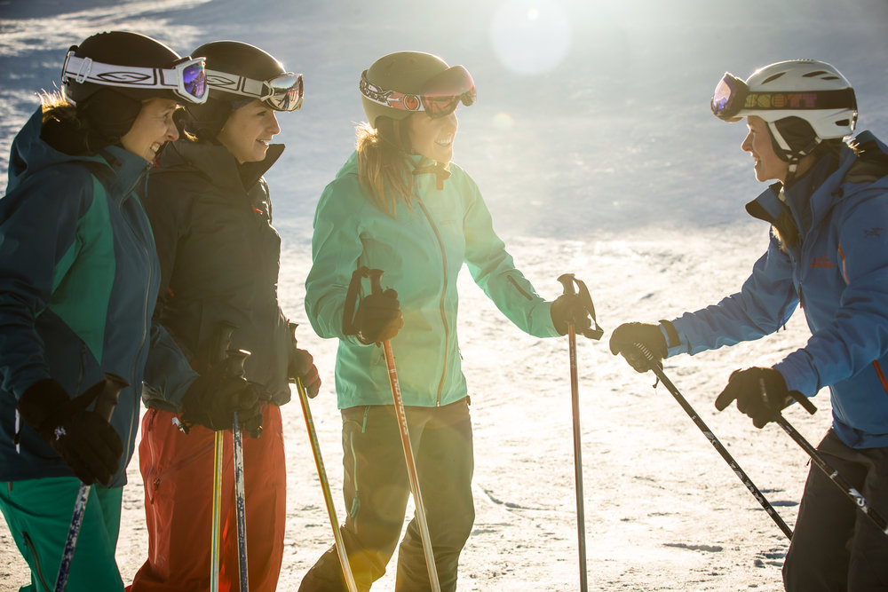 A group of skiers receive instruction at one of Whistler Blackcomb's camps for women. - © Whistler Blackcomb
