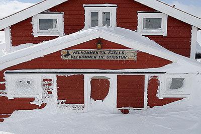 Haus im Schnee - © Hülle