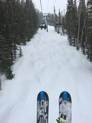 Deer Valley Resort - It's snowing! About 25 degrees and overcast. Cold enough to accumulate. Nice! Call it an inch of new over machine groomed at 10:00 am with more to go. This is Silver Strike chair - © another random iPhone