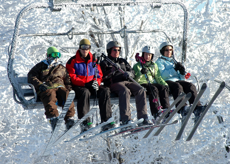 Skiers on chairlift at Seven Springs PA