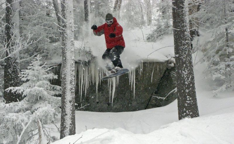 A snowboarder gets air at Magic Mountain, Vermont