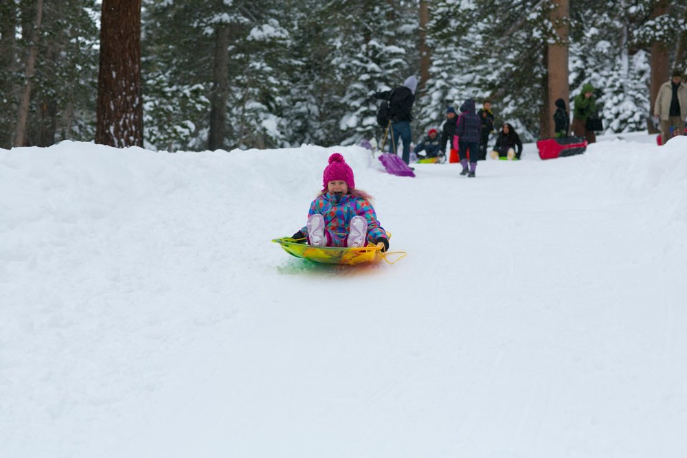 The best hills for sledding on your own are just outside of town off the Mammoth Scenic Loop or along the 395 corridor.  - ©Mammoth Lakes Tourism