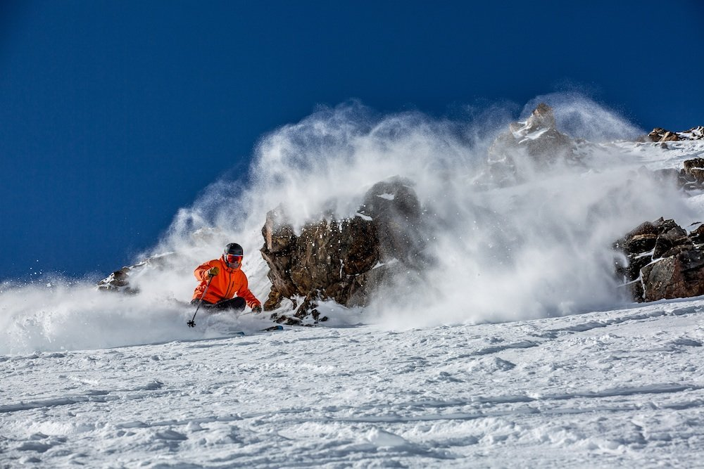 Leaving a vapor trail in the Breck Lake Chutes. - © Breckenridge Ski Resort