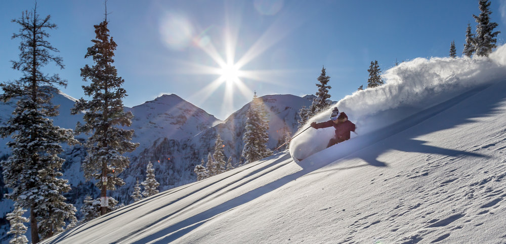 A skier enjoys fresh snow in Telluride off of the Plunge Lift (Lift 9) - © Telluride Ski REsort