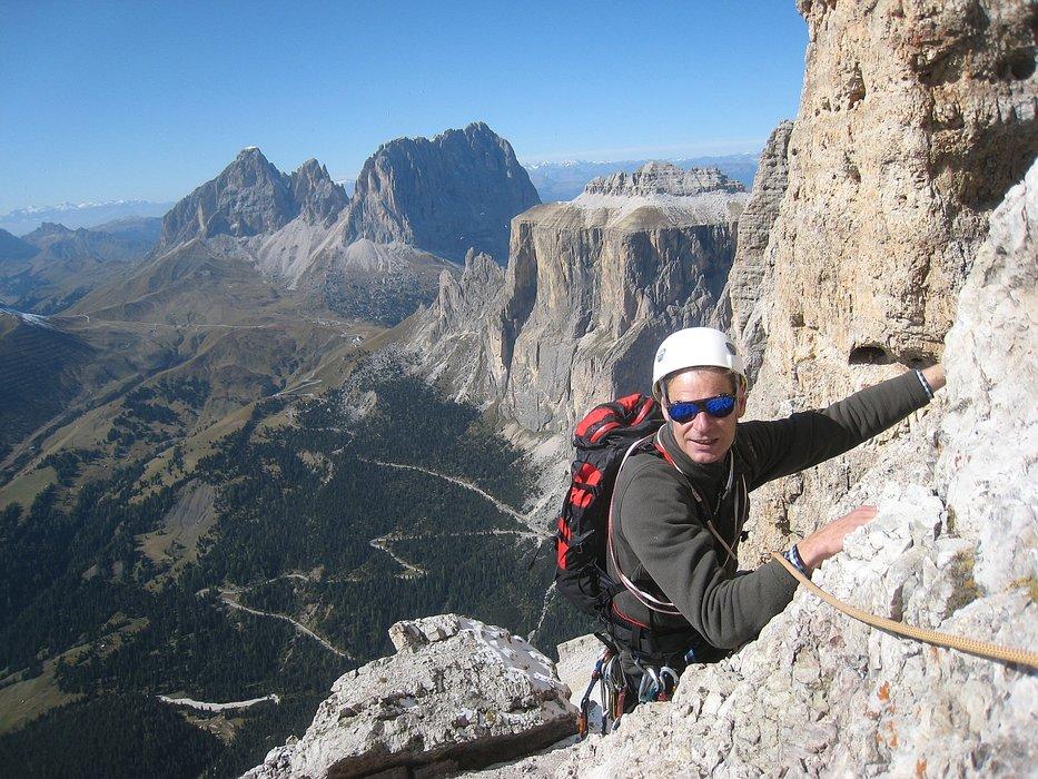 A rockclimber high over Val Gardena.