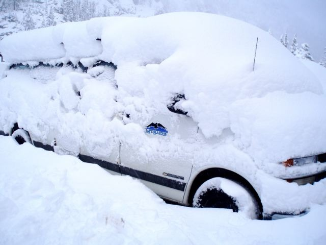 Car covered in heavy snow