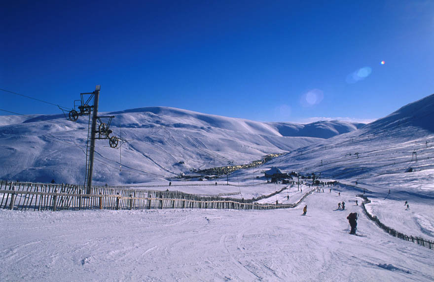 Looking across from the Cairnwell ski runs at the Glenshee Ski Centre with the buildings of the complex visible across to Sunnyside, northeast of the Spittal of Glenshee, Aberdeenshire.