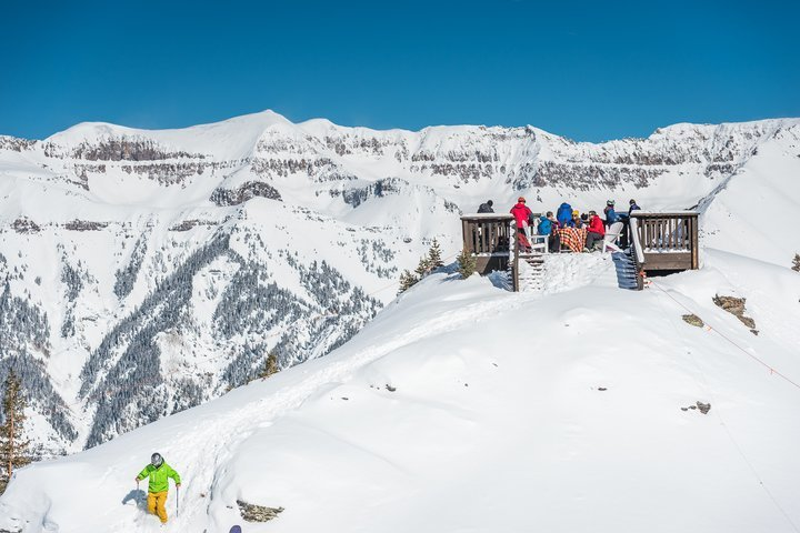 The deck at the bottom of Revelation Bowl is a sweet spot for a picnic lunch before dropping in. - © Visit Telluride/Ryan Bonneau