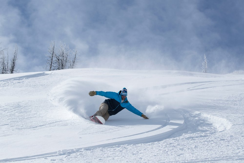 Slashing big turns on opening day. - © Wolf Creek, Scott DW Smith