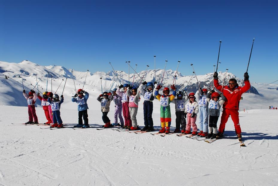 Children pose for a picture at ski school in Oz en Oisans, France.