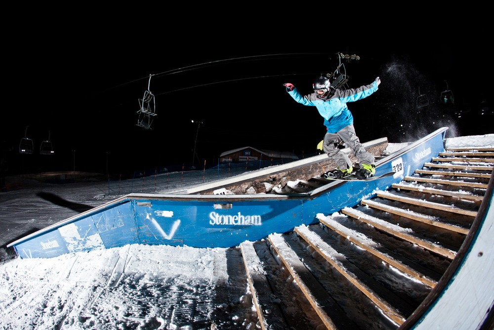 Snowboarder Julien Beaulieu slides a staircase setup in the Stoneham snowpark. Photo: Oliver Croteau/ Courtesy of Stoneham Mountain.