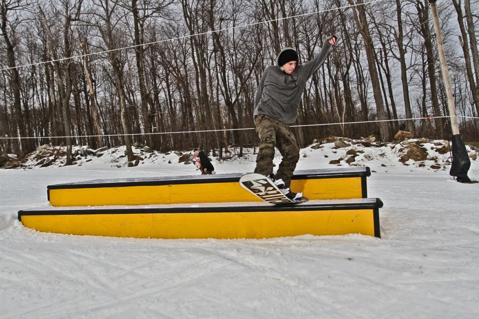 A snowboarder presses a box at Seven Springs terrain park. Photo Courtesy of Seven Springs.