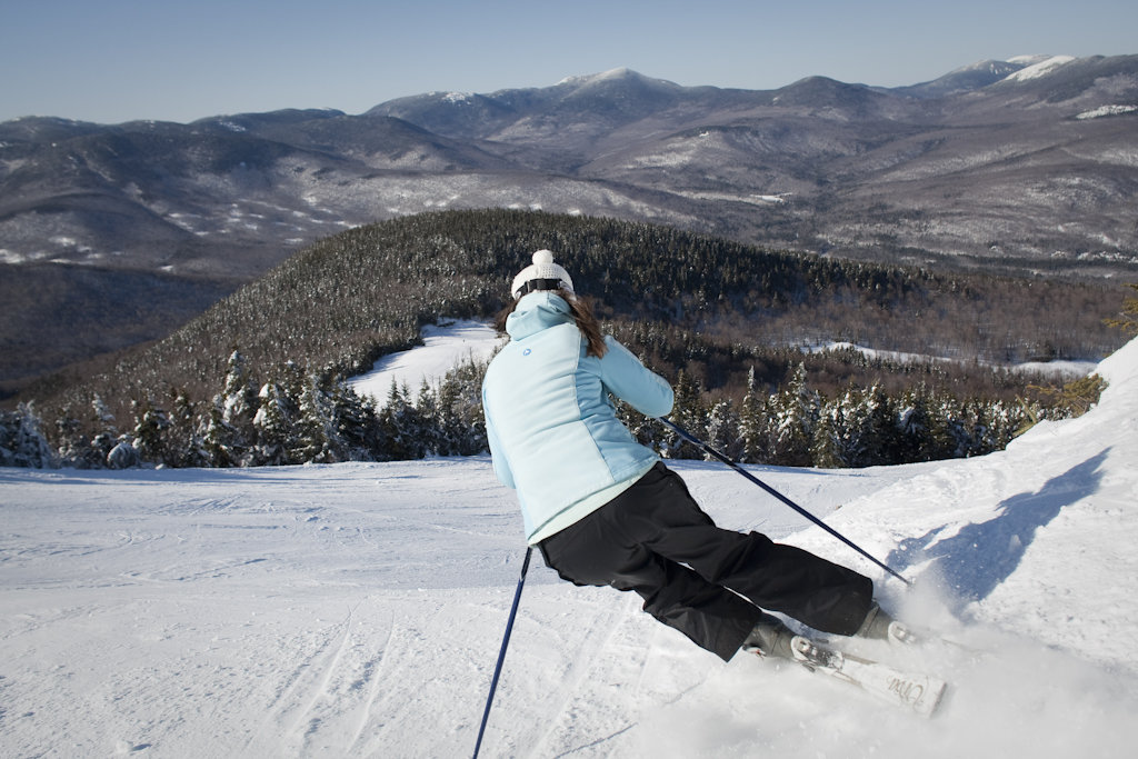 A skier admires beautiful views while cruising down the slopes.  - © Sunday River