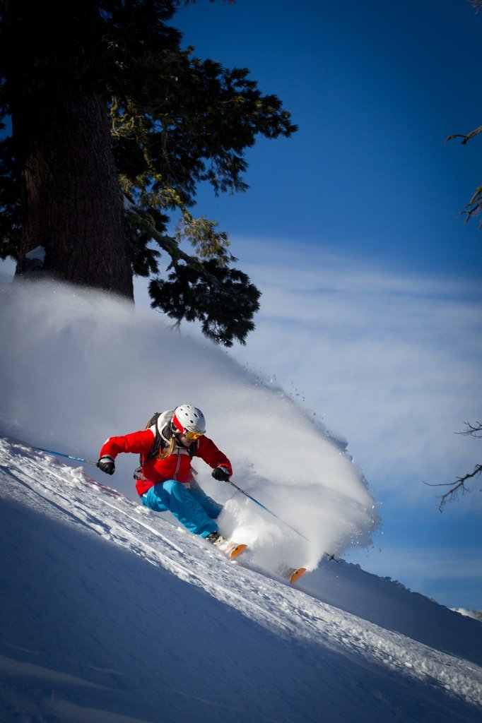 Hitting her mark perfectly, Amie catches the early morning light at Squaw Valley Ski Resort.  - © Jeff Engerbretson