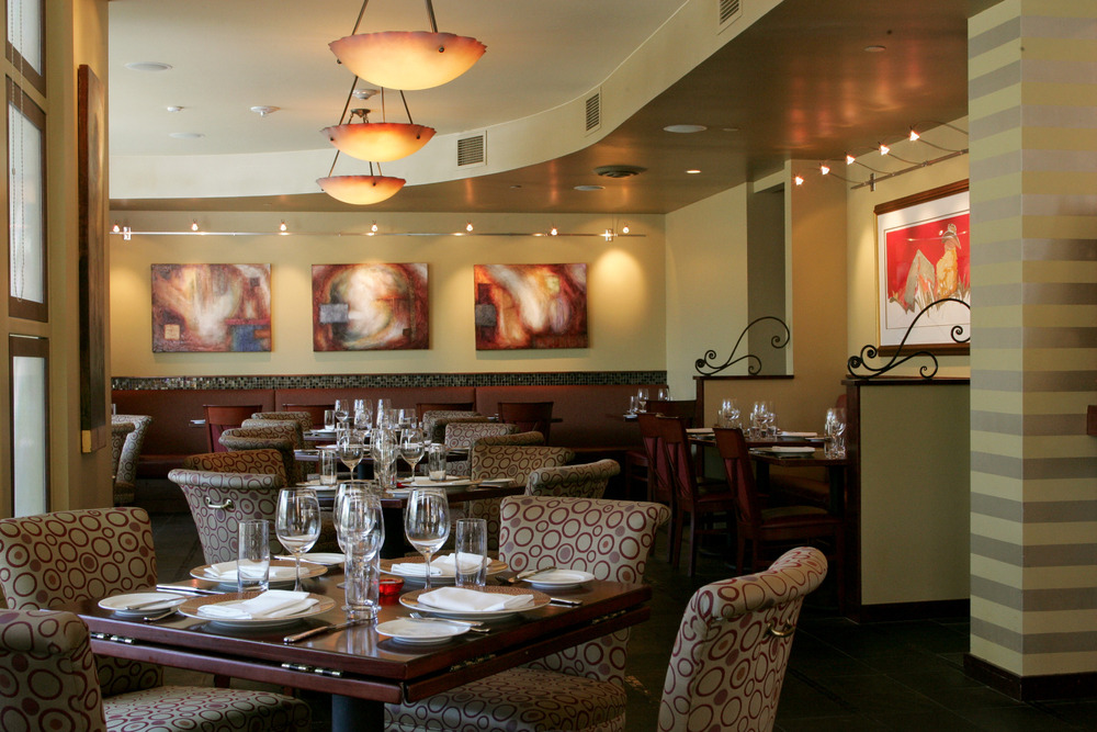 The intimate dining room at Kelly Liken features fantastic lighting and artwork not to mention Kelly's world-class cuisine.  - © Kelly Liken