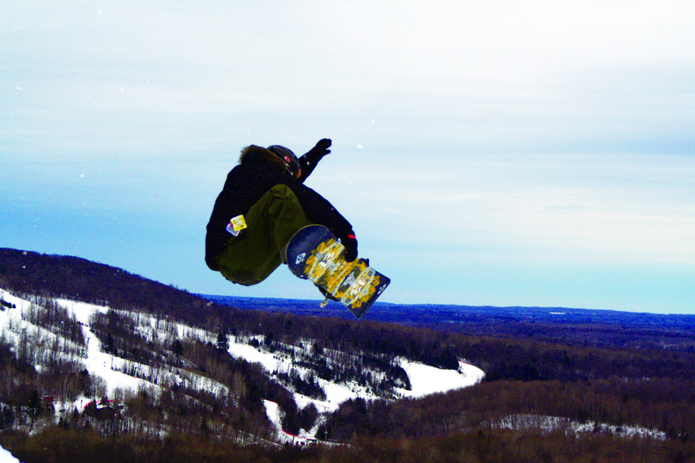 Snowboarder gets major air and a scenic view in Indianhead Mountain, Michigan