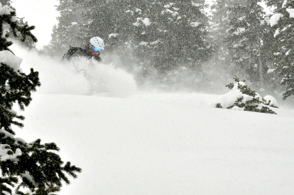 Eric Rasmussen hits a stash on Peak 9 at Breck. - ©Josh Cooley