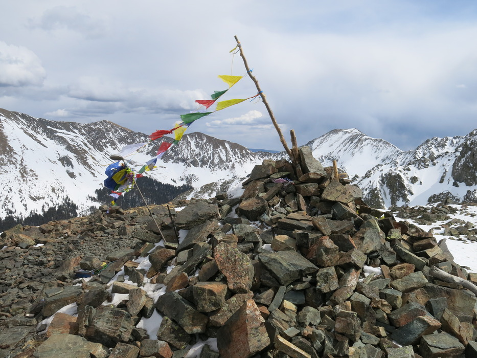 Tibetan prayer flags at the top of Kachina Peak. - © Donny O'Neill