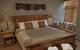 The bedroom of a 1 bedroom/1 bathroom condominium at the Edelweiss Lodge & Spa. - © Edelweiss Lodge & Spa