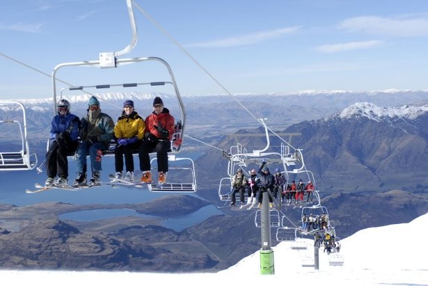 Very busy quad lift at Treble Cone, NZ.