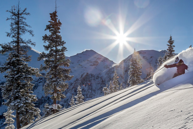 A skier enjoys fresh snow in Telluride off of the Plunge Lift (Lift 9)