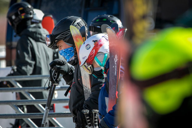 Skiers wear masks in liftline at opening day at Keystone, Colorado