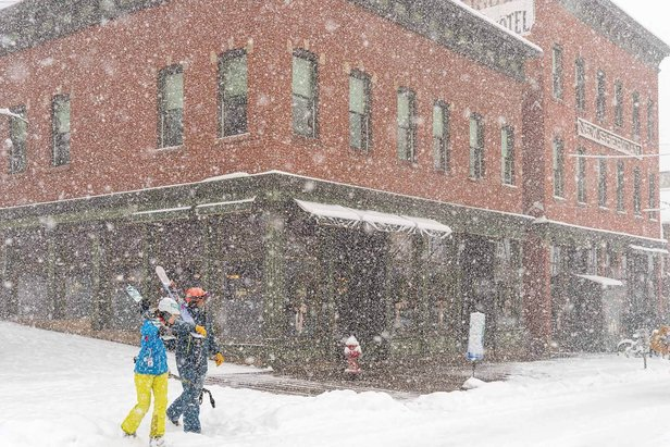 Skiers make their way to the slopes through fresh snow.  - © Visit Telluride/Ryan Bonneau