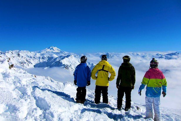 Skiers look out over the Andes.