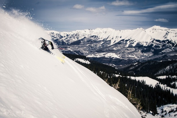 Soft snow and grand vistas await spring skiers in Telluride. Skier: Herb Manning