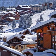 Snow-clad luxury chalets in Courchevel, France - © Courchevel Tourist Office