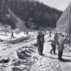 Passengers collect their gear after getting off the ski train in the 1950s. - © Winter Park