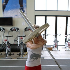 Heather McPhie demonstrates how she stays healthy as the ski season comes an end with Barbell Rotations. - © OnTheSnow.com